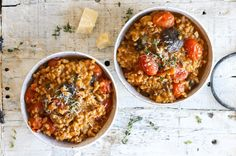 Creamy Tomato and Mushroom Farrotto | Farrotto is risotto's whole-grain, cooler older cousin. Farrotto uses chewy farro instead of rice, but still mimics risotto's cooking technique and borrows its luxurious texture for a true one-pot wonder. Here, we perk up out-of-season tomatoes by blistering them on a screaming hot cooking surface to concentrate their flavor. Shiitake mushrooms add umami-rich depth and meaty texture to this vegetarian main. This recipe can easily be made vegan by…