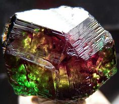 """Dravite crystal exhibiting the """"Usambara effect"""" color change (named after nearby mountains) / Nchongo, Umba Valley, Tanzania"""