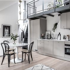 The metal staircase in this beautiful attic home gives this space a industrial loft look. A minimal grey kitchen is placed underneath the metal staircase, making space for a small living area and on the second floor you can find … Continue reading → Tiny Living, Living Spaces, Living Area, Scandinavian Loft, Loft Industrial, Loft Stil, Style Loft, Gravity Home, Minimalist Apartment