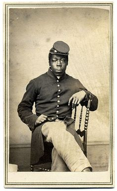 Pvt. Jefferson Ramsey by Gayford & Speidel of Rock Island, Ill. Ramsey served his entire enlistment in the 108th U.S. Colored Infantry. This image was part of an album of cartes de visite of enlisted men in Company F of the regiment. The album was assembled by Theodore F. Wright, one of the lieutenants in command of the company.