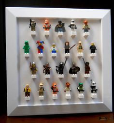 Lego minifigure display by TheLittleManCave on Etsy, $26.00    This is a really neat idea!