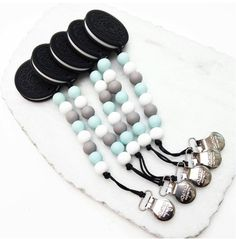 (http://www.spearmintlove.com/cookie-silicone-teether-baby-blue-grey/)