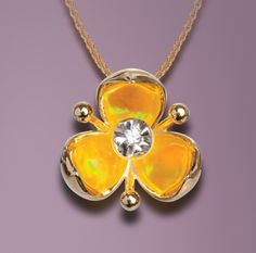 Illusia Pendant from Galatea with hidden yellow opal spreading color behind the diamond. Style A5.