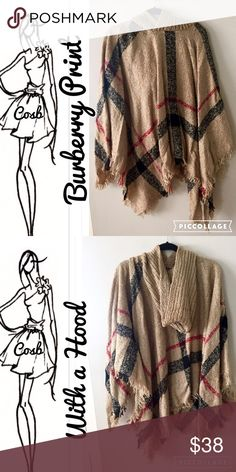 Burberry print poncho w/Hood Burberry print poncho. Poncho is tan plaid w/black & red piping. Poncho has an all tan hood. Poncho is One Size Cosb Sweaters Shrugs & Ponchos