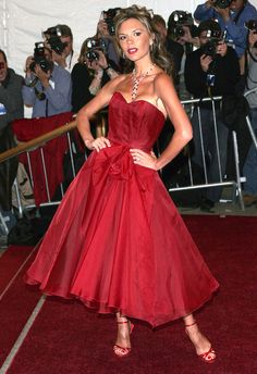 "Victoria Beckham at the 2006 Met Gala; the theme that year was ""Anglomania"", and Posh Spice is appropriately donning a royal red tea-length dress. Victoria Fashion, Victoria Beckham Style, Evening Attire, Gala Dresses, Costume Institute, Tea Length Dresses, Spice Girls, Fashion Gallery, Couture Fashion"