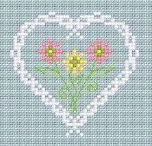 flowers and white heart on blue cross stitch / Coeur fleuri