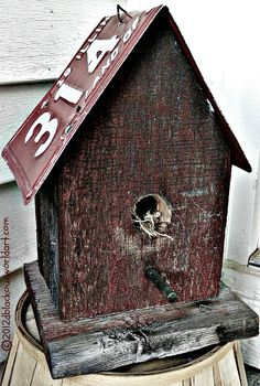 Rural birdhouse crafted from old barn wood & an Illinois license plate...part of my front porch decor. ~<3