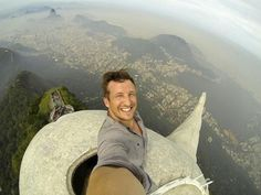 Self Portrait (Selfie) by Photographer Lee Thompson atop the 2,300-foot statue of Christ the Redeemer 2014
