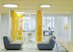 Inblum Architects designs Wix offices in Vilnius with glazed meeting rooms and colorful curtains
