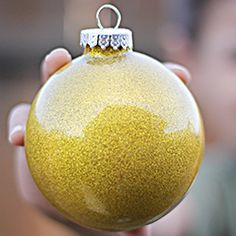 Glitter Ornaments for kids, find out how to make this easy craft kid-friendly.