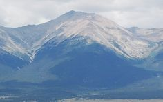 Mount Antero in Colorado.  You can hunt for Aguamarines, but it's 14,000 feet high.  And the road is 6 miles and takes 2 HOURS!