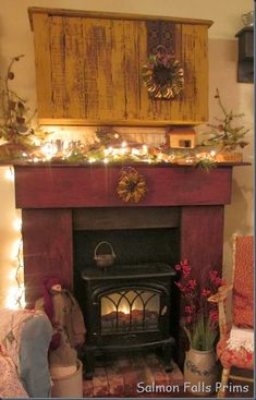 primitive homes on picturetrail Primitive Homes, Primitive Fireplace, Primitive Living Room, Fake Fireplace, Primitive Furniture, Country Primitive, Fireplace Mantels, Fireplaces, Electric Fireplace