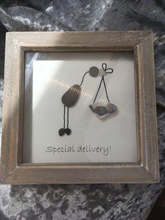 Pebble art stork, new baby picture