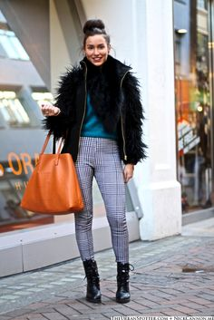 turquoise jumper.  black/white skinny trousers. black ankle boots.  black shaggy cropped jacket and ... a pop of orange arm candy!  great photo urbanspotter