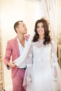 British recording artist, Katie Melua and Russell Blackburn of @Miss Black Bridal Couture fitting her Claire Pettibone wedding gown (BridesMagazine.co.uk)