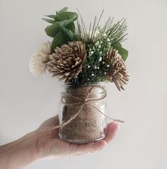 Eucalyptus & Pine Mini Mason Jar Floral Arrangement Winter is coming! Lovely mini Sola Wood flower arrangement surrounded by faux foliage and ready to display in an adorable, clear mason jar. Christmas Flower Arrangements, Table Flower Arrangements, Christmas Table Centerpieces, Christmas Flowers, Winter Flowers, Flower Centerpieces, Christmas Decorations, Wedding Centerpieces, Western Decorations