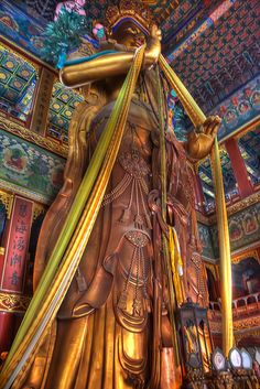 Statue of Buddha in the Lama Temple, Beijing    The Pavilion of Ten Thousand Happinesses in the Lama Temple houses this magnificent 80-foot high sculpture of the Maitreya Buddha, which is carved from a single piece of sandalwood.