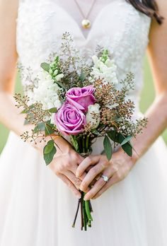 Brides.com: . A simple posy comprised of purple roses, white stock, and eucalyptus, created by Sweet SaraBell Weddings & Events.