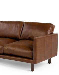 The Carey 3 Seater Sofa in Saddle Tan Premium Leather. Retro design, but superbly soft. £999 | MADE.COM