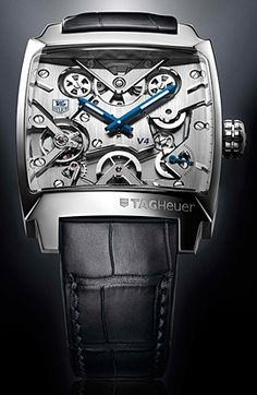 The perfect watch for clouting your manservant on the head when he forgets your soy latté. What can I say I like this exposed gnashing beast of a watch. The blue hands against the silver face are especially nice touch.