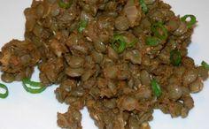 A simple lentil dish with onions, garlic, tomatoes, cumin, coriander, turmeric: http://www.tastygalaxy.com/cook/how-to-cook-lentils-lentils-with-onions-garlic-tomatoes-cumin-coriander-turmeric/
