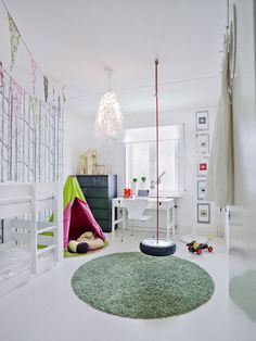 I like the wall decal, bunting and the tyre hanging from the ceiling!