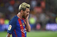 Barcelona's Argentinian forward Lionel Messi leaves the pitch at the end of the…