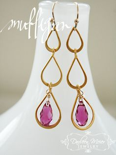 The Mulligan earrings are an effortless chic way to wear a bright bold color. Purple swarovski crystals hang from a 24K gold plated three tear drop