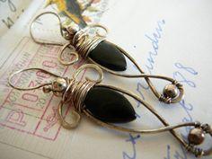 King Arthur sterling silver earrings.