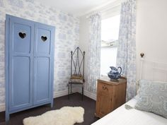 Soothing shabby chic bedroom in blue and white.
