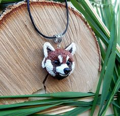 Red panda head pendant I made of polymer clay, waxed cord  The size of the head panda is about 1.57 inches or 4 cm.  May be insignificant difference, but I promise you that... #polymerclay #animaltotem #jewelryanimals #vialatteaart