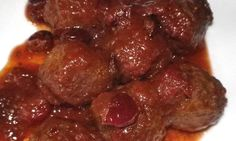 Crock Pot Cranberry Sweet and Spicy Meatballs is a crowd pleaser and so easy to make!  www.getcrocked.com