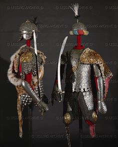 Two sets of Polish scale-armour (Karacena) with leopard skins, helmets and sabers. All metal parts lined with red velvet. Helmets with feathers, helm cap with silk edge.    Wawel Castle, Cracow, Poland