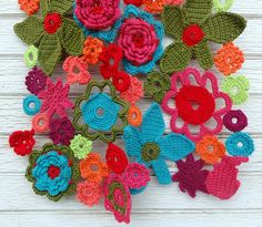 Flower power crochet scarf - I love the colors and the fact that it would be an unconventional art form