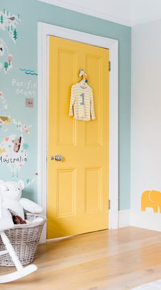 This sweet pastel toned world map is perfect for your little one's nursery or bedroom, featuring illustrated animals from all over the world in a cute and educational style. The sea is coloured in a soft duck-egg tone that creates a calm and light colour scheme. #wallpaper #murals #wallmurals #interior #design #home #homedecor #decor #accentwall #inspiration