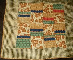 1860's homespun and calico doll quilt.  Brown calico backing.