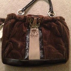 Authentic Juicy Couture bag! Beautiful brown authentic Juicy Couture bag with embossed velvet, silk sash/bow on side and chain gold details. Practically new condition! Approx. 10x14 inches. Happy to accept reasonable offers :) Juicy Couture Bags