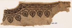Textile fragment from the neck of a garment with vines and leavesfront10th - 15th century AD Material and techniquelinen, embroidered with brown silk; with stitching in flax