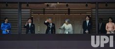 Japan's Emperor Akihito(L3) waves to well-wishers with Empress Michiko(L4), Crown prince Naruhito(L2), Crown princess Masako(L), Prince…
