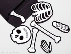 printable party invitations - the bones have the different details for the party on them.