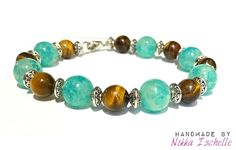 """An """"everyday"""" bracelet with TigerEye gemstone, quality glass beads, and sterling silver.  Handmade by Nikka Ischelle"""