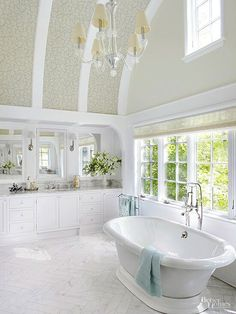 Barrel-vault ceilings heighten interest (especially when accented with pretty wallpaper and curved trim), make rooms feel larger, and create taller end walls. In this bathroom, a single window installed above tidily aligned casements makes good use of the Dream Bathrooms, Beautiful Bathrooms, Modern Bathroom, Small Bathroom, Master Bathrooms, Luxury Bathrooms, Master Baths, Family Bathroom, Bad Inspiration