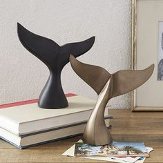 Whale Tail Sculptures. Could DIY by forming out of clay (polymer, paper, foam) and then spraypainting your desired color.