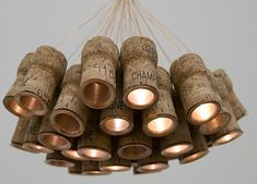 This creative chandelier is made from hollowed champagne bottle corks with LED inside. It is a creation by designer Alkesh Parmar. Dubbed as the Celebration Chandelier, the eco friendly lighting. Beer Bottle Chandelier, Led Chandelier, Pendant Lights, Chandeliers, Chandelier Ideas, Jar Lights, Led Lamp, Wooden Lamp, Wooden Diy