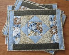 This set of 4 placemats feature the Robert Kaufman Asian Traditions fabrics. The centre block of these placemats is a gorgeous floral print in browns, gray and gold. The gold that runs through these fabrics give the placemats a richness that would enhance any décor. The placemats measure 14.25 by 18.25 inches. The fabrics used in these placemats is 100% cotton. The interior is a layer of Insul-Brite batting which provides the placemats with some insulation to protect your table. They…