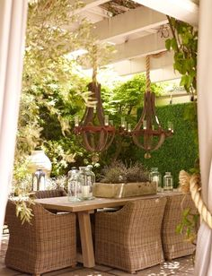 Outdoor room with a pergola, curtains tied back with rope and fabulous lighting~Providence Design