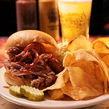 Try the delicious pulled pork sandwich at One Hot Mama's barbecue restaurant on Hilton Head Island in South Carolina - VisitSouth.com