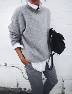 Picture Of grey pants, a white shirt, a grey sweater and a black bag for any work