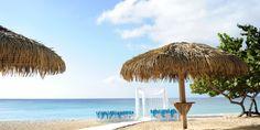 Beach wedding ceremony set up by Celebrations Ltd., Caribbean Club wedding on Grand Cayman by aaronrebarchek.com