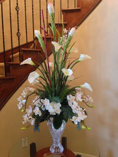 Calla lily with orchid flower arrangement for perfect foyer or staircase. By Arcadia Floral and Home Decor.